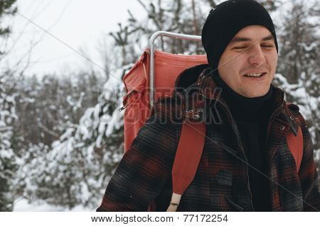 smiling man in the winter forest