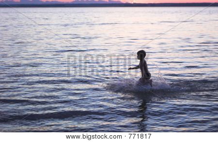 boy on rhe sea sunset