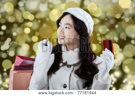Cheerful Shopaholic With Credit Card