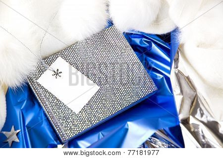 Blank Card On Silver Note Book