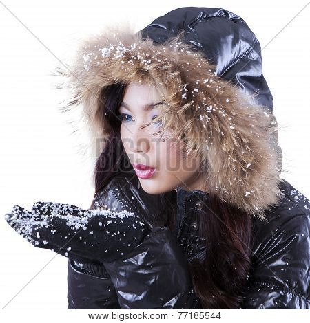 Lovely Lady Blowing Snow On Palms