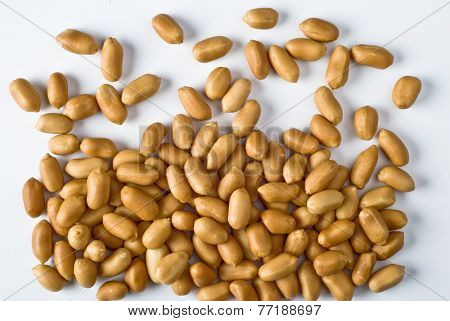 Group of scattered peanuts on white background - top view