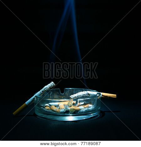 Ashtray And Two Cigarettes