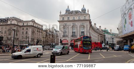 Wide shot of People and traffic at the edge of Regent's street, central London.