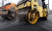 stock photo of paving  - Street paving with rollers and paving machines