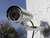 stock photo of supervision  - Surveillance infra red camera mounted on wall - JPG