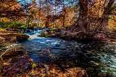 stock photo of guadalupe  - Waterfalls and Beautiful Fall Foliage Surrounding the Guadalupe River Texas - JPG