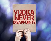 pic of vodka  - Vodka Never Disappoints written on colorful background with defocused lights - JPG