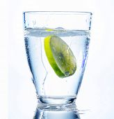stock photo of minerals  - a glass of fresh drinking water and a lime - JPG