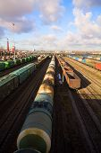 stock photo of boxcar  - Freight train with color cargo containers in depot - JPG