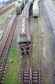 foto of boxcar  - Freight train with color cargo containers passing railway station - JPG