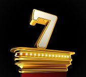 foto of number 7  - Number Seven on a golden platform with brilliant lights over black background - JPG