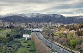 picture of tehran  - Tehran skyline and greeneries in front of Alborz Mountains as viewed from atop of Nature Bridge edited with vintage filter - JPG