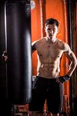 foto of pugilistic  - Young man boxing workout in an old building - JPG