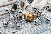 pic of plumbing  - plumbing and accessories on wooden table engineering - JPG