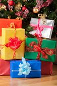image of rudolf  - Colorful Christmas presents underneath the Christmas tree - JPG