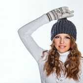 stock photo of knitted cap  - Cute teen girl in a knitted cap and sweater close - JPG