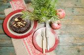 stock photo of desert christmas  - Still life with chocolate cake Christmas tree and pomegranate - JPG