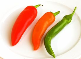 foto of red hot chilli peppers  - red orange and green chilli pepper on plate - JPG