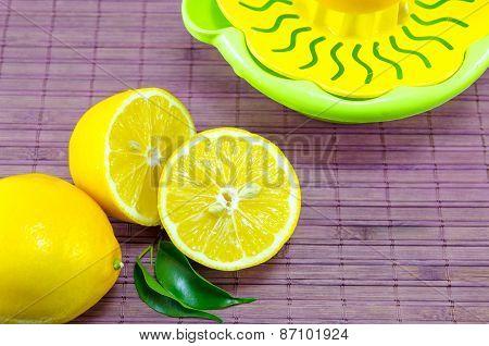 Halved Lemons And A Colander