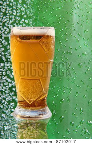 Froth Beer Glass With Reflection On Green Drips Background.