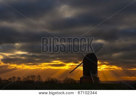 Brill Mill Silhouetted Under Dramatic Skies