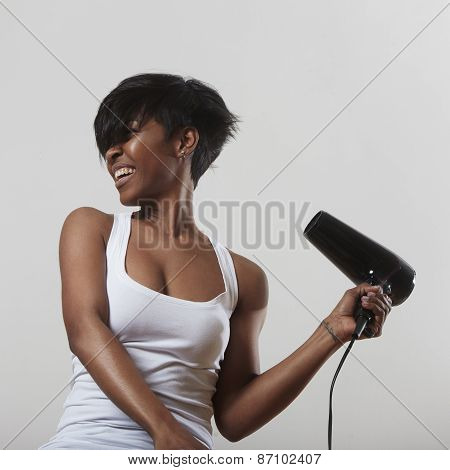 Black Woman With A Hair Dryer