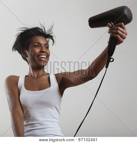 Happy Woman With A Short Haircut And Hair Dryer