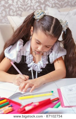 School girl doing writing