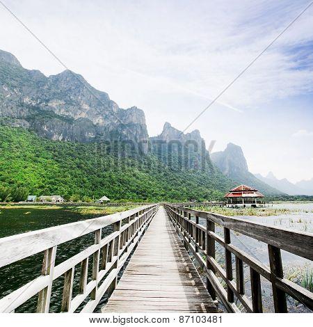 Wooden Bridge To The Rock Mountain