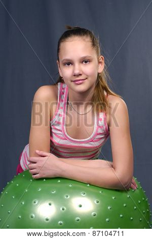 the young girl costs with a sports ball