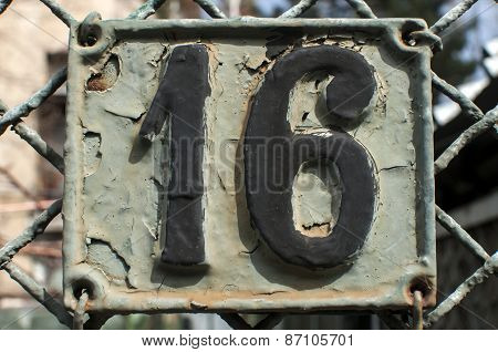 Old retro cast iron plate number 16