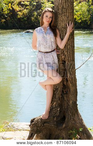 Attractive Model Relaxes By A Tree Beside Small River