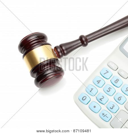 Wooden Judge's Gavel And Neat Calculator Next To It
