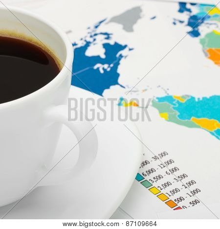 Coffee Cup Over World Map - Business Concept