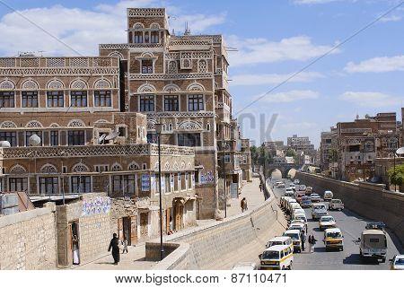 People walk by the street of Sanaa city in Sanaa, Yemen.
