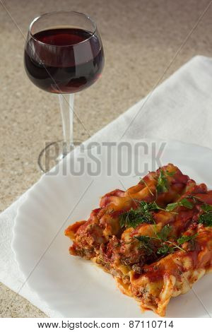Stuffed Meat Cannelloni And Glass Of Wine