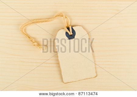 Vintage Price Tag Label On Wooden Texture Background