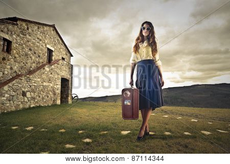 Woman travelling in the countryside