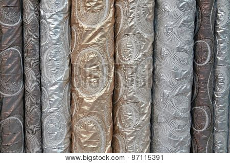 A variety of different bolts of brocade fabric