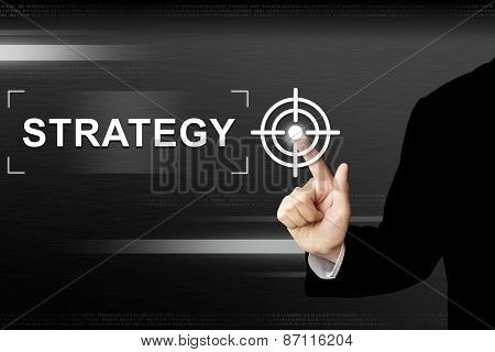 Business Hand Pushing Strategy Button On Touch Screen
