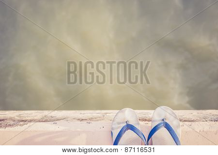 White Rubber Shoe On Cement Edge Near Sea