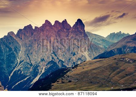 Great view of the National Park Tre Cime di Lavaredo. Dolomites, South Tyrol. Location Auronzo, Italy, Europe. Dramatic overcast sky. Beauty world. Retro filter and vintage toning effect.