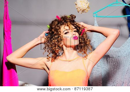 Woman With Clothespins In Hair