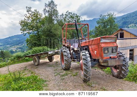 Tractor With Trailer Parked On A Hillside