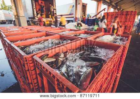 Fish In Red Basket And Defocused Of Worker
