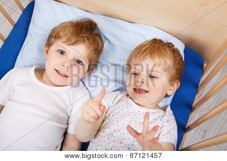 Little Sibling Boys Having Fun In Bed At Home