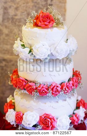Beautiful Wedding Cake In Different Colors With Three Different Levels.