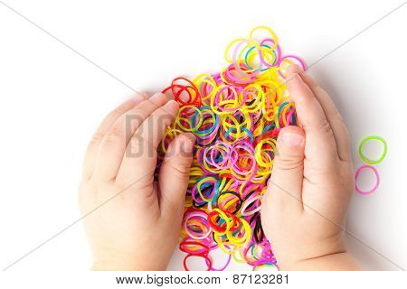 Child Hands And Pile Of Small Colorful Rubber Bands