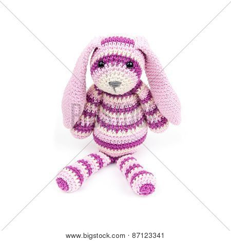 Knitted Rabbit Toy Is Sitting Over White Background